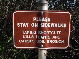 Stay on sidewalks sign (American Trails photo)